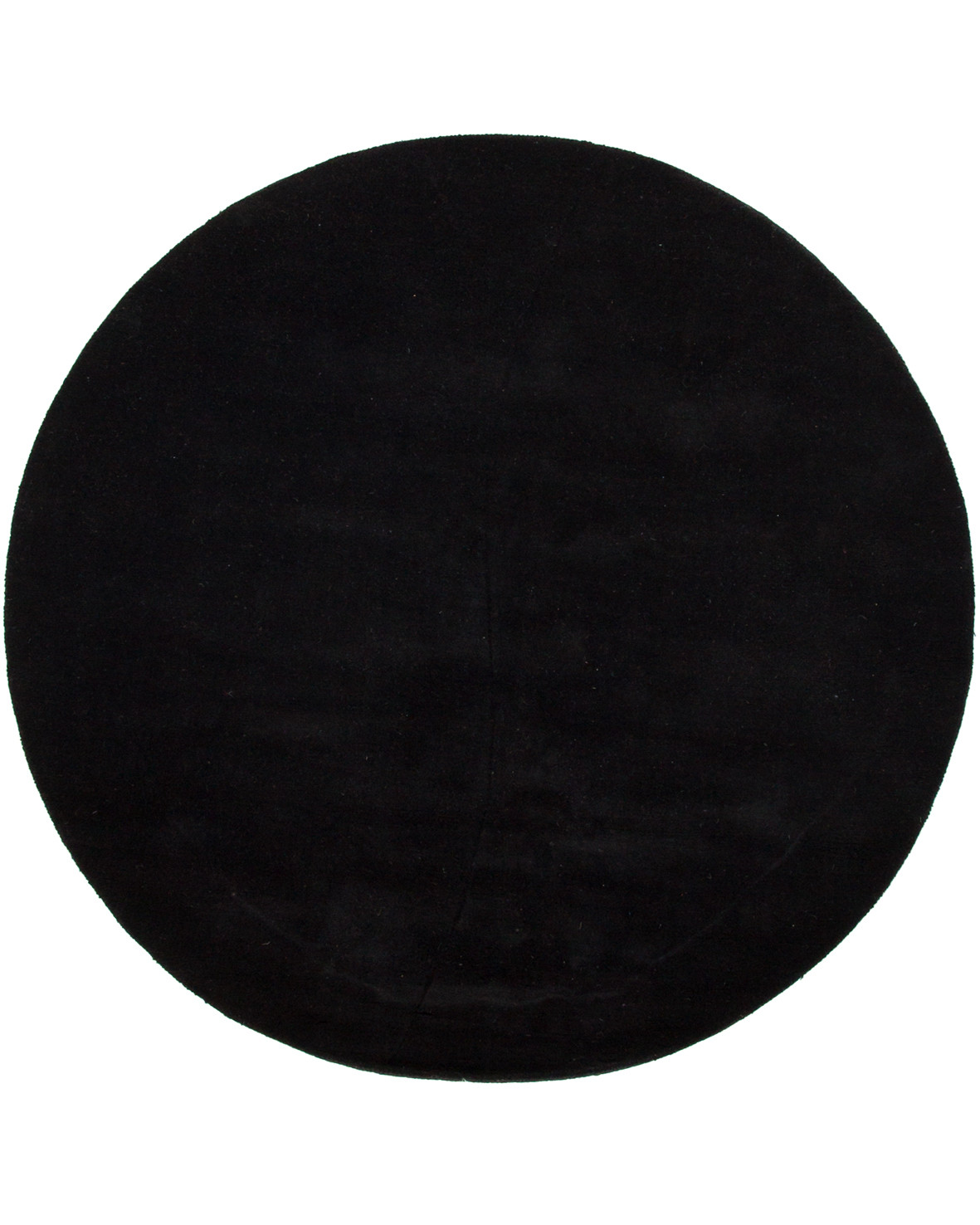 Moon rund svart enfärgad ullmatta med lugg